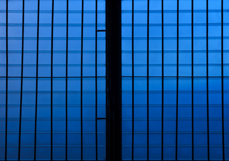 louver: Silhouette of dirty louver window at twilight. Blue tone.