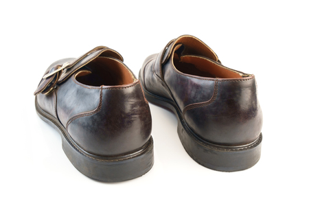View of old leather shoes on white background.