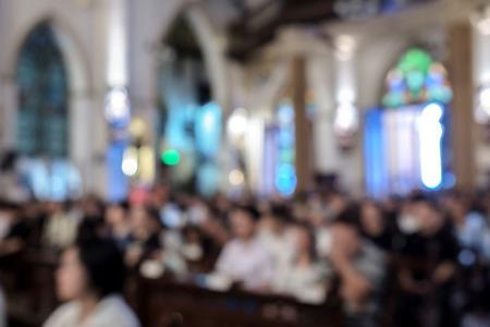 Blur people in the church. 免版税图像