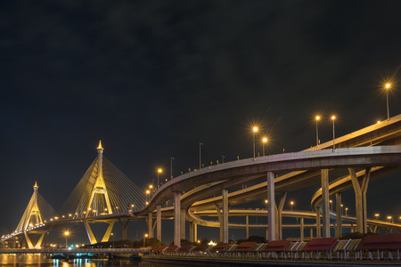 View of elevated expressway at night.