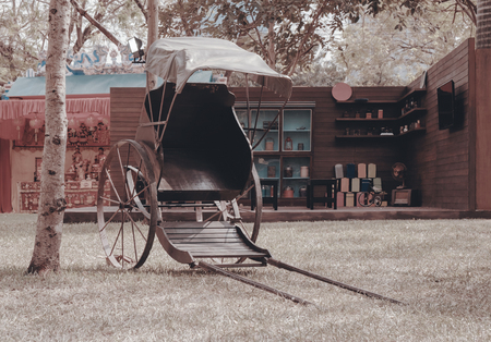 View of traditional Chinese rickshaw on the ground.