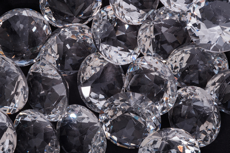 View of diamond on dark background. Selective focus.
