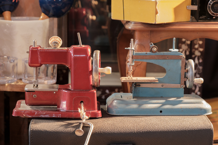 sewing machines: View of sewing machine, vintage toy. Stock Photo