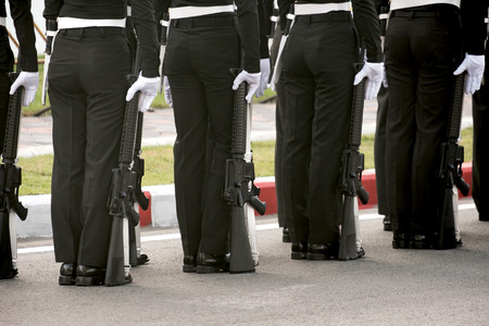 View of soldier standing with gun on parade. Stock Photo