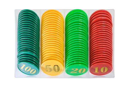Casino chips in plastic container on white background. Stock Photo