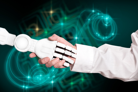 Handshake of scientist and robot on technology background.