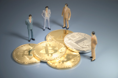 View of cryptocurrency and businessman toy on the table.