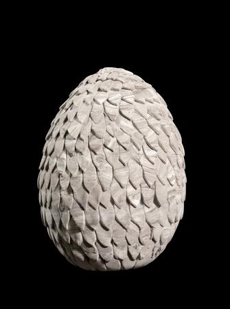 Dragon egg on black background. Clay craft.