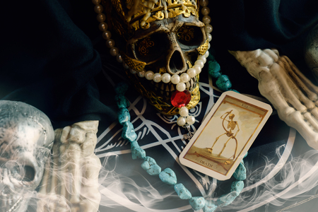 View of tarot card on the table. The Death. Shallow depth of field. Imagens