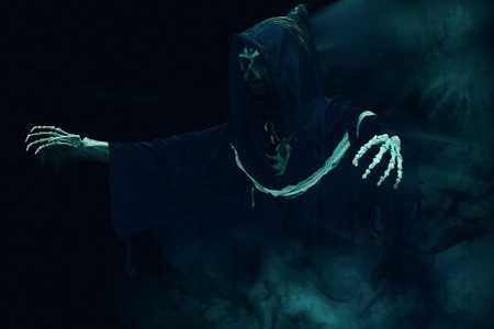 View of grim reaper on smoke background. Grim Reaper, The Death.