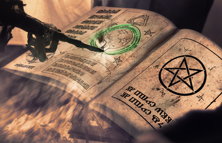 View of hand pointing of witch on scripture. Dark tone. Shallow depth of field. Text mean : on the moon  in the sky