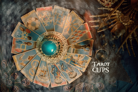 View of Tarot card (Minor arcana) and crystal ball on the table. Tarot of cups. Banco de Imagens