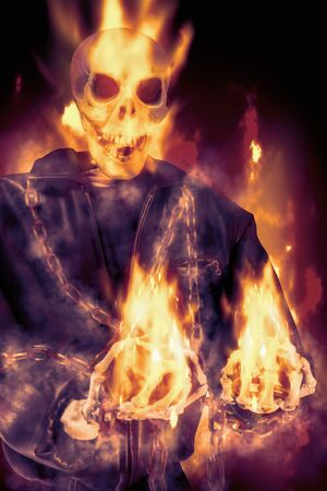 View of skeletal with fire on dark background.