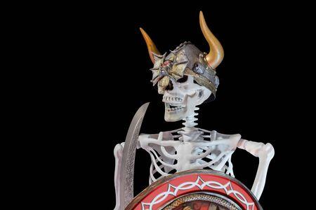 View of skeletal warrior on black background.