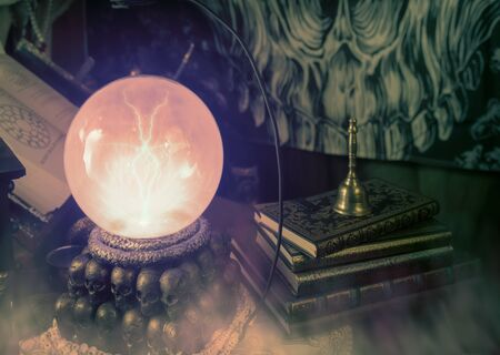 View of crystal ball with light in dark room. Stockfoto