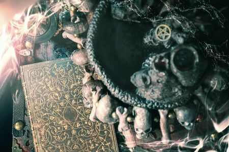 View of book on the table in the dark ritual room.