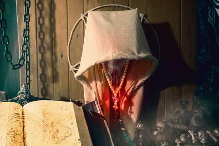 Hooded goat skull hang on the dark ritual room. Stockfoto