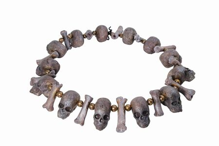 Skull necklace on white background. Clay craft.