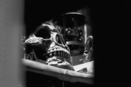 View of dirty skull on the table. Black and white tone. Soft focus.