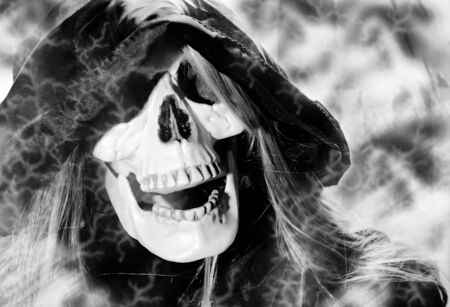 Portrait of hooded skeleton on smoke background. Black and white tone.
