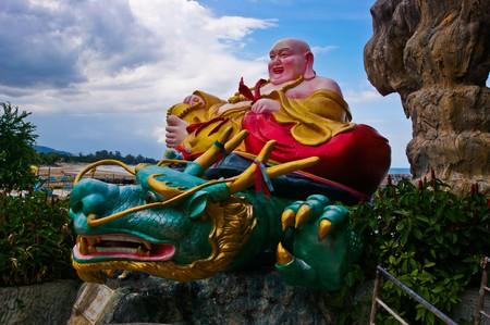 Smiling Buddha of wealth statue on WatThamKhaoTao, Thailand