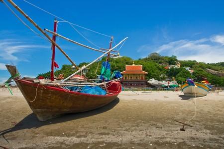 Fishing boats at cha-am beach in Thailand photo