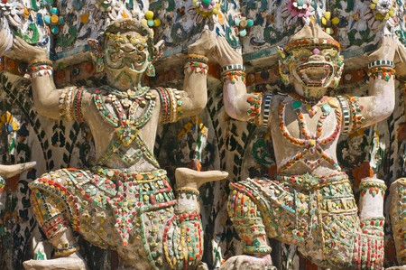 Close up of demon statue on the Buddhist temple Wat Arun in Bangkok, Thailand.