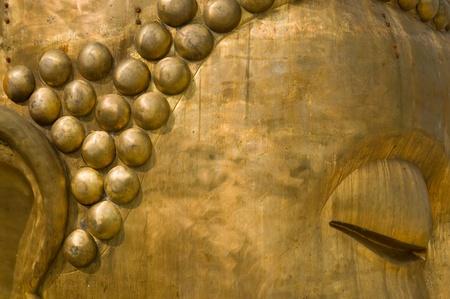 Close-up of buddha statue . photo
