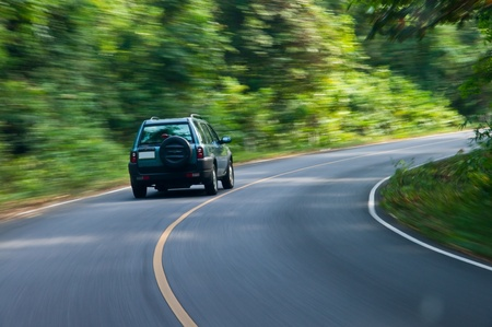 curve road: car on the road wiht motion blur background.  Stock Photo