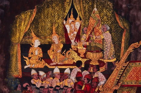 Traditional Thai art on a wall at the  temple, Thailand