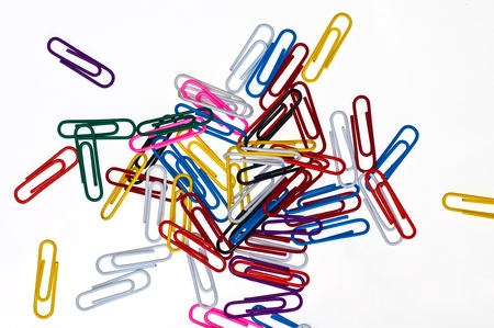 Colorful paper clip isolated background photo
