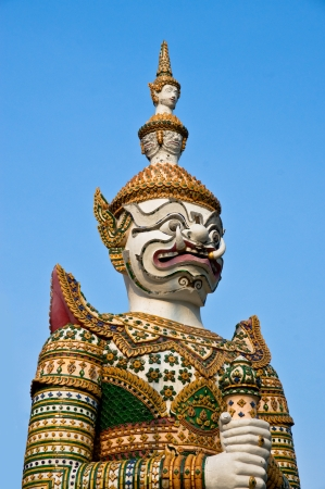 Guardian Statues at the temple in Thailand  photo