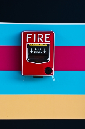 fire alarm on colourful wall  photo