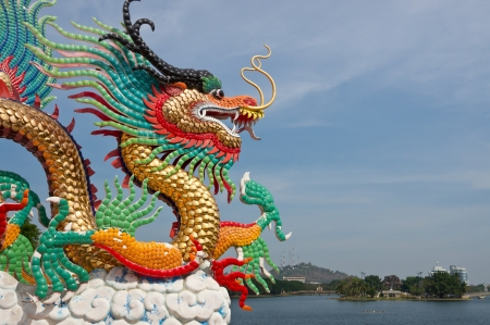 Colorful dragon statue on blue sky  photo