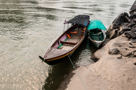 old wooden row boat at the river Stock Photo