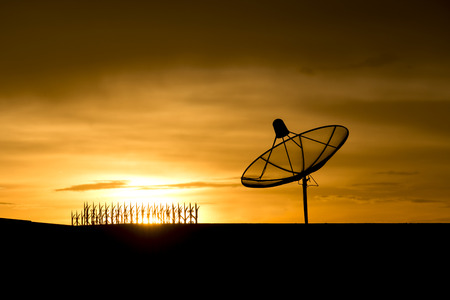 transmit: Silhouette of Satellite dish with sunset sky Stock Photo