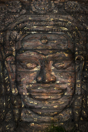 formidable: Ancient stone faces of Bayon temple, Angkor, Cambodia