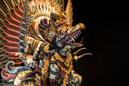garuda: Garuda statue isolated on black background