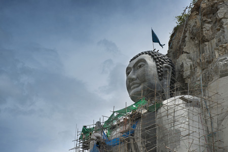 Giant Buddha was carved out of a cliff face in Thailand.
