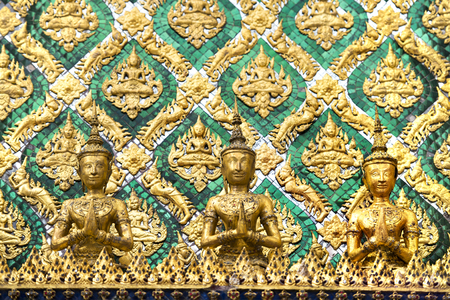 Detail of carvings on temple wall at Wat Phra Kaew, the Temple of Emerald Buddha in Bangkok, Thailand