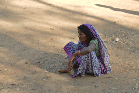 GAYA,BIHAR, INDIA- March 20, 2019 YHomeless hungry poor old,women sitting on the side of the road,