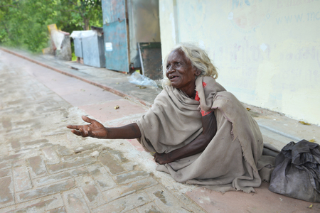 GAYA,BIHAR, INDIA-October 16 2019: An Indian woman begging on the streets Editorial