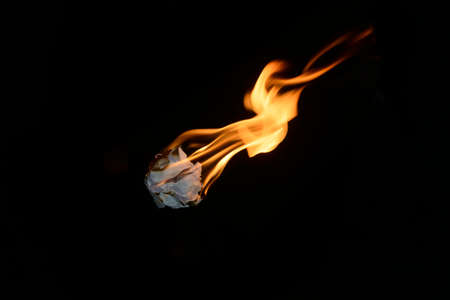 Burning of the crumpled sheet of paper Stock Photo