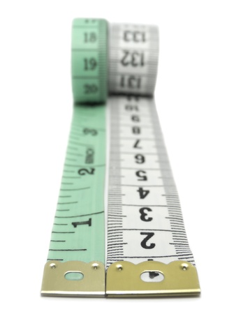 Close-up of two measuring tapes isolated on white Stock Photo - 9390602