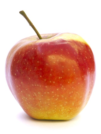 Close-up of an apple resting on acrylic paper isolated on white Stock Photo - 9444509