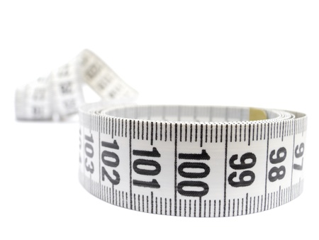 Close-up of a white measuring tape isolated on white Stock Photo