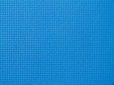 Close-up of a blue fitness mat surface texture