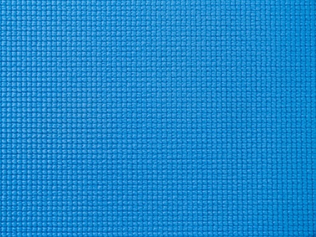Close-up of a blue fitness mat surface texture