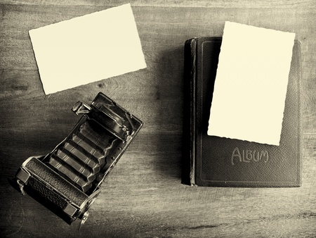 Old camera with album and two empty pictures Stock Photo - 9830956
