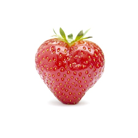 Heart-shaped strawberry isolated on a white background photo
